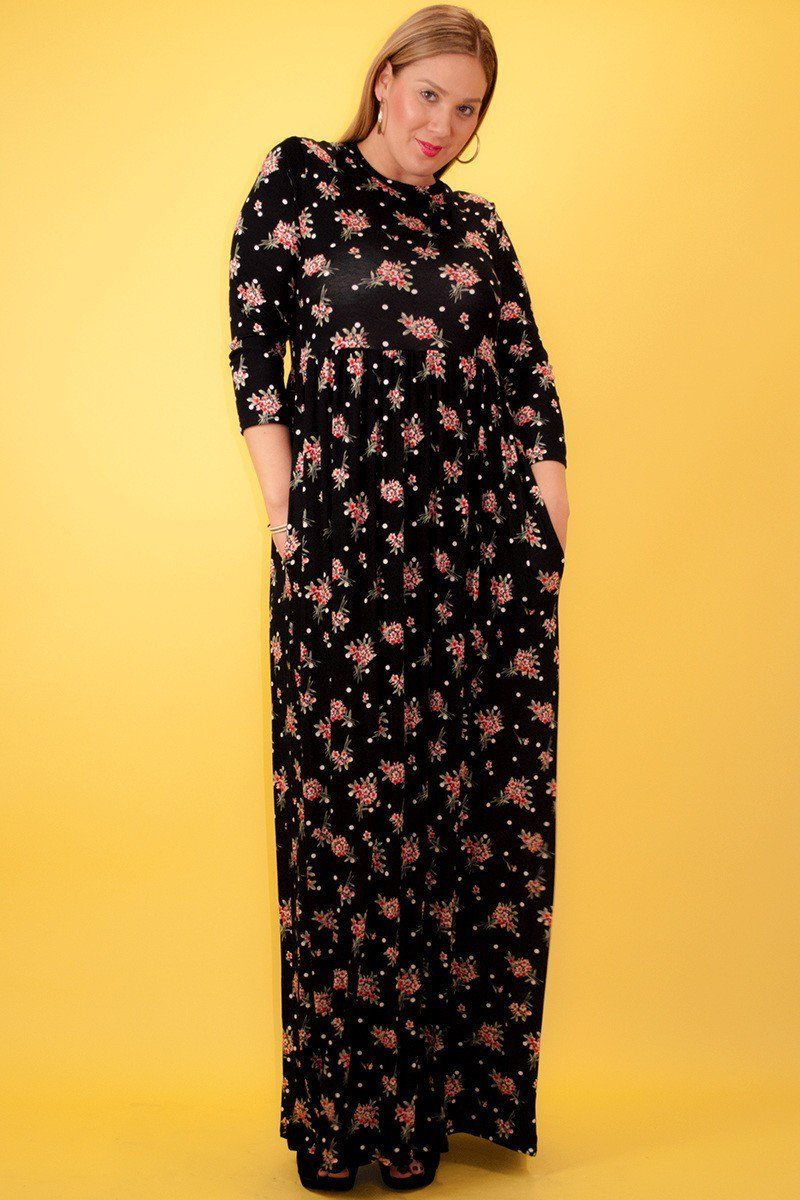 ''Floral printed, maxi DRESS in a fit and flare style, with long sleeves, a crew neck, and pleats-id.