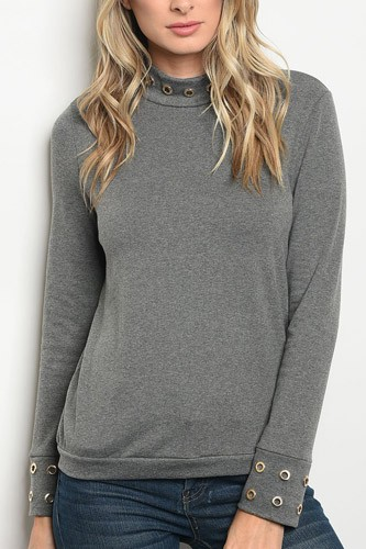 Ladies fashion long sleeve sweater top with a mock neckline and grommet details along the cuffs-id.33977