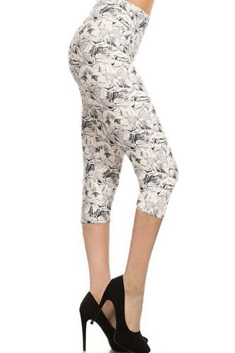 Cat print, high waisted capri leggings in a fitted style with an elastic waistband-id.cc52815